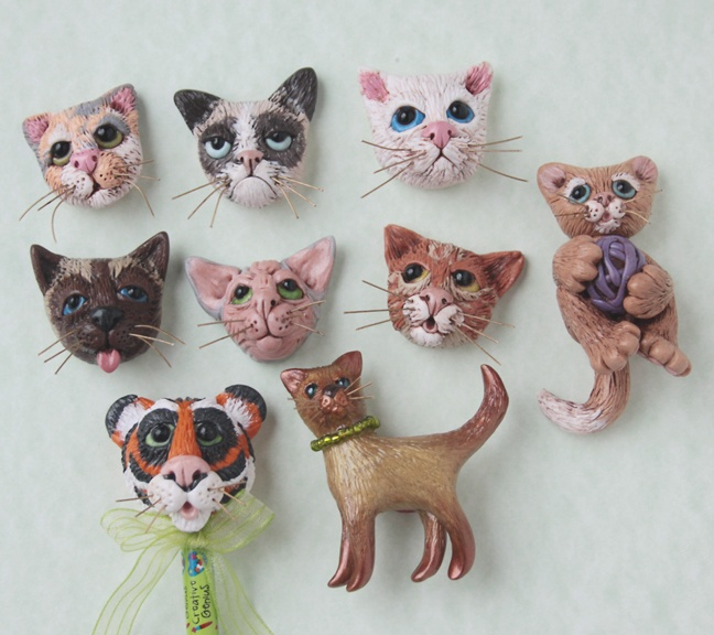 Book 4 cat heads beads and cats. My daughter wanted me to make a sphynx and the 'angry cat' she saw on the internet had fun with that. Shouldn't have antiqued them... they just look dirty... I guess I have a bunch of dirty kitties with bad hygiene!