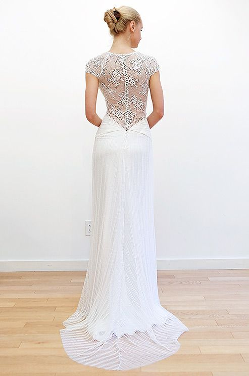 The shimmering lace back of this Cocoe Voci gown will give your guests something glam to look at during your ceremony.