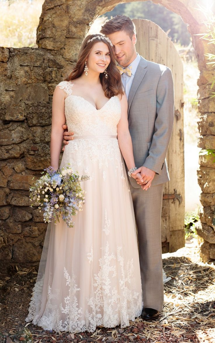 Essense Of Australia S Lace Over Matte Side Lustre Satin A Line Plus Size Wedding Gown Features Sparkling Beading Elegant Cap Sleeves In Lace