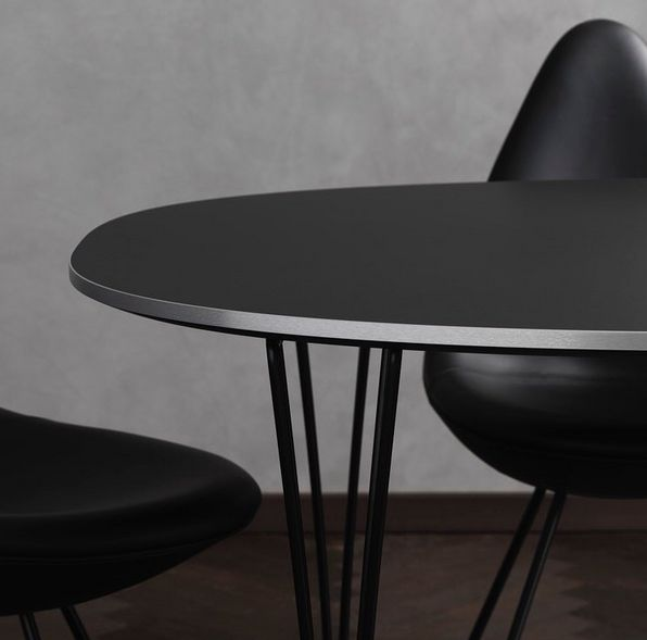 Graphic shot of Arne Jacobsen's Drop™ Chair the Black Edition crafted in Sorensen Leather. Recently launched by Fritz Hansen