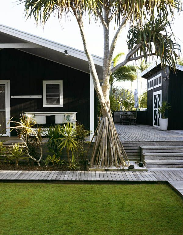 Black house with white trim. One of my favorite looks. Love the sleep out too :)