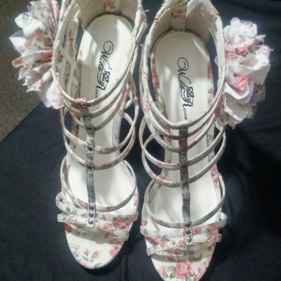 Floral Strappy High Heel Sandals Floral print, strappy, high heeled sandals with back zippered closure and side rose accents. Shoes Heels