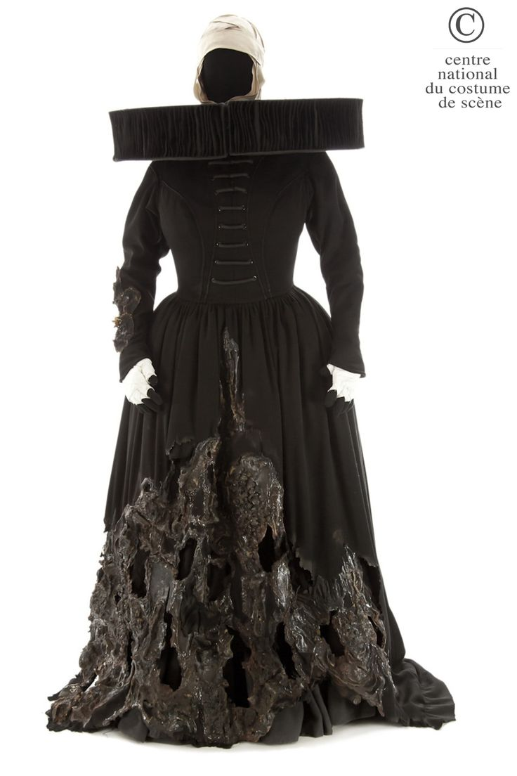 """Thierry Mugler, costume for the first witch, latex appliqués with """"burnt"""" effect on the skirt, pleated satinette ruff, from Shakespeare's Macbeth, Carlo Tommasi, 1985"""