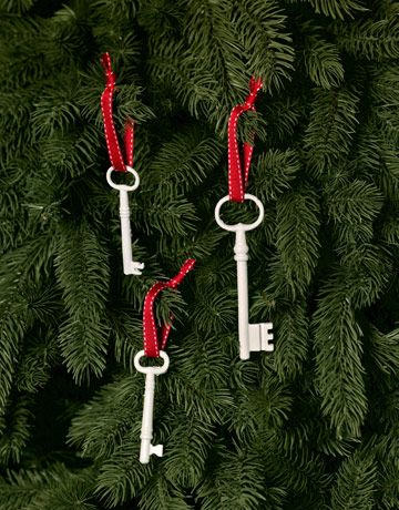 Spray painted skeleton keys, glossy white or any other color, as ornaments. I love this.