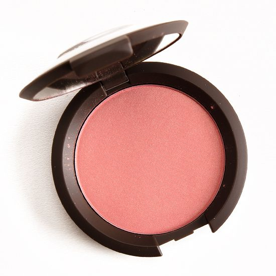 """Becca Flowerchild Mineral Blush ($32.00 for 0.20 oz.) is described as a """"peachy pink, golden highlights."""" It's a light-medium, rosy pink with warm underton"""