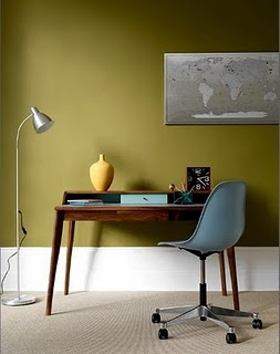"""Avocado walls, modernist desk, and turquoise chair.  Graham Atkins-Hughes To see more of the color-saturated wall trend, follow Jill Jordan's board """"Jewel-tone Rooms""""."""