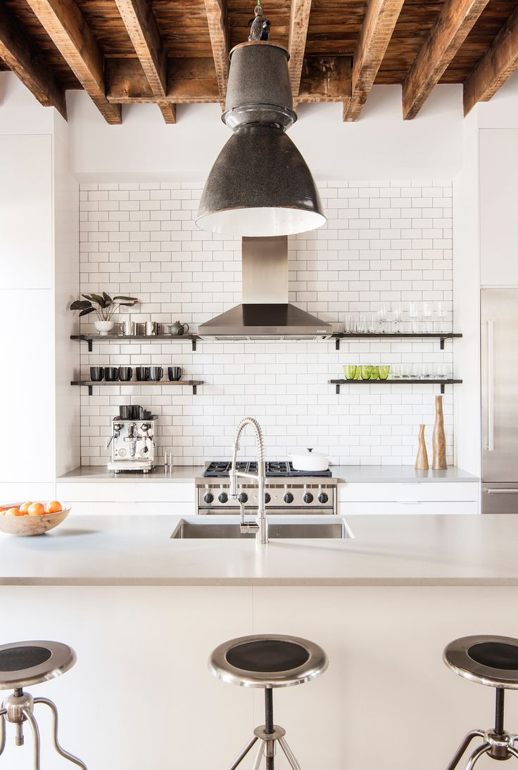 Stainless steel sink by Elkay with Blanco Meridian Semi-Professional Kitchen Fauces, both sourced from Davis & Warshow in Manhattan. Subway tile is Metro from Nemo tile. Brackets for open shelves from Rejuvention.