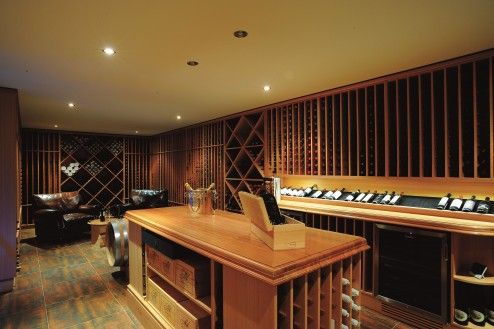 Storage, Awesome Modern Commercial Wine Cellar Interior Design With Wood Countertop Wine Room Island With Wine Shelves As A Tasting Table Also Floor To Ceiling Modular Wine Storage Design Decoration Idea ~ Amazing Wine Cellar Decorating Ideas Enhancing the Storage with Antique Impression