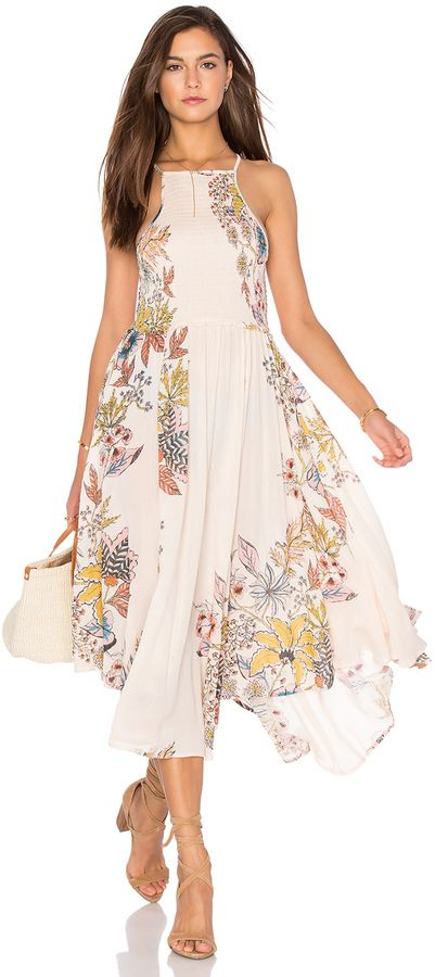 Great flowy dress with floral print and high neckline. Free People Season in the Sun Dress