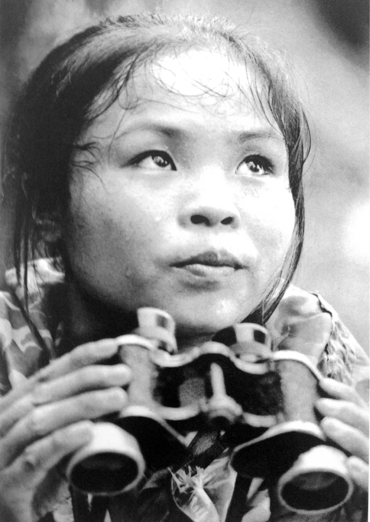 Viet Cong Youth Volunteer La Thi Tam counts bombs dropped by American bombers. This was to enable delayed-fuse bombs to be located and deactivated. 1967
