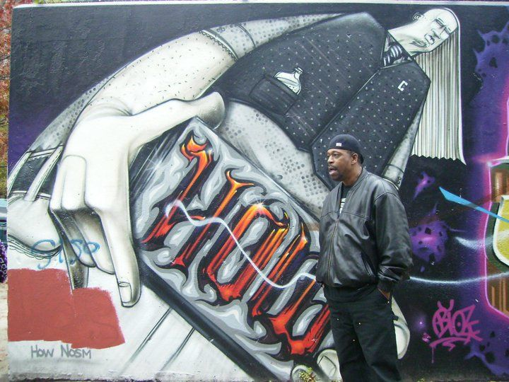 Grandmaster Caz next to the Graffiti Wall of Fame, East Harlem NYC, November 2010