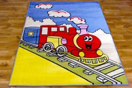 Dywan dziecięcy ręcznie wycinany Wesoły Pociąg. Kolorowy dywan dla dzieci z motywem kolorowego pociągu, wzory na dywanie są ręcznie wycinane, dzięki czemu nadają mu trójwymiarowego efektu.