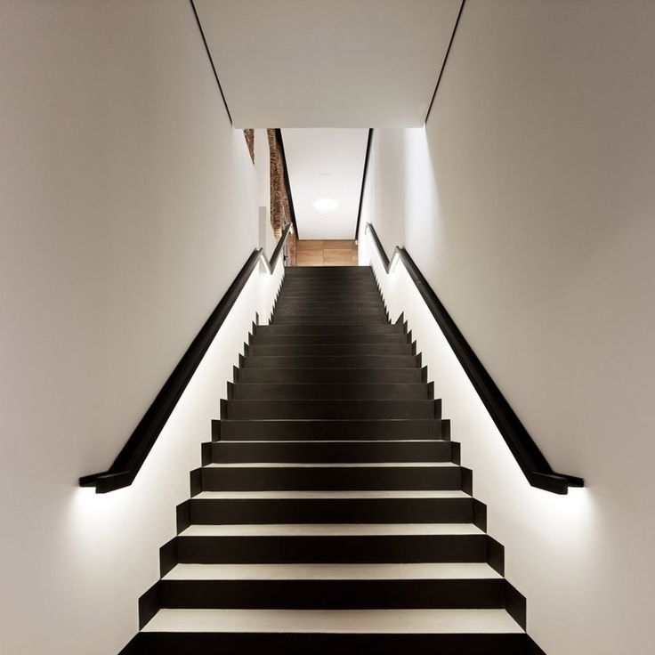Black and white staircase with lighting along