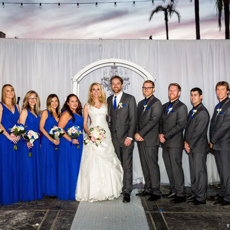 Royal blue and charcoal grey wedding party for a beach wedding. Photography: True Photography Weddings See more here: http://frtx.co/WBOivB