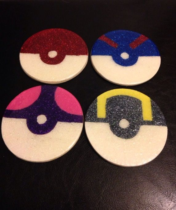 Making minimalist nerd coasters to sell at my next craft table. Here are my nearly finished pokéball ones! Painted, glittered and epoxy'd!