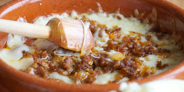 Queso Flameado (Melted Cheese with Onions and Chorizo) - This is one of the most beloved dishes in Mexico, both in restaurants and homes alike. Who doesn't love gooey, melted cheese? And even more so when it's crowned with spicy chorizo?