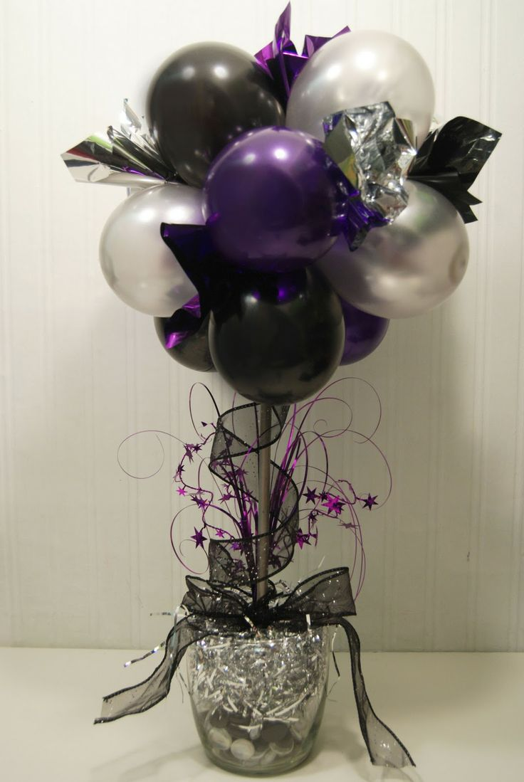 With a color change and a bit of tweaking, this would be an awesome centerpiece for my daughter's 18th Masquerade party.
