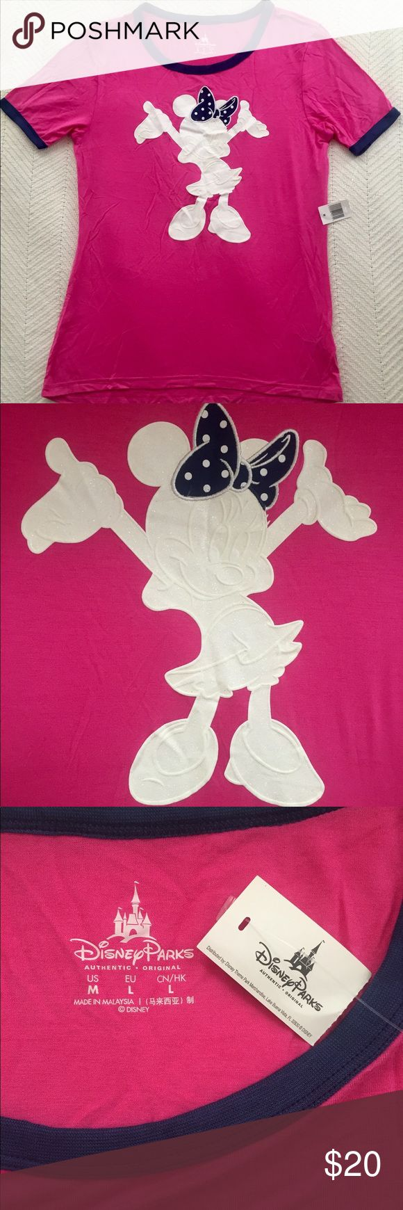 Pink Minnie T-Shirt NWT! Pink Minnie T-shirt! Minnie is covered in white sparkles with a cute polka dot bow. Fits like a women's medium. Never worn, received as a gift. Disney Tops Tees - Short Sleeve