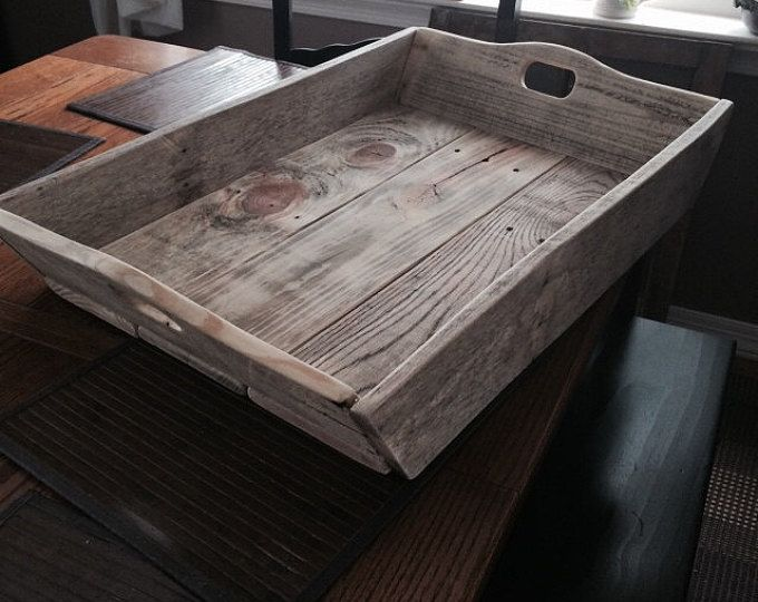 A Bucks County craftsman constructs beautiful serving trays using repurposed wood. The beauty of these pieces is the wood grain, knots, and nail holes, giving the wood a distressed finish. Handles are built in and sizes are approximate as no two trays are exactly alike.  SMALL Approx. 18 x 12 x 3
