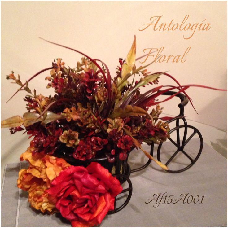 Arreglo de flores artificiales en base de metal en forma de bicicleta ...