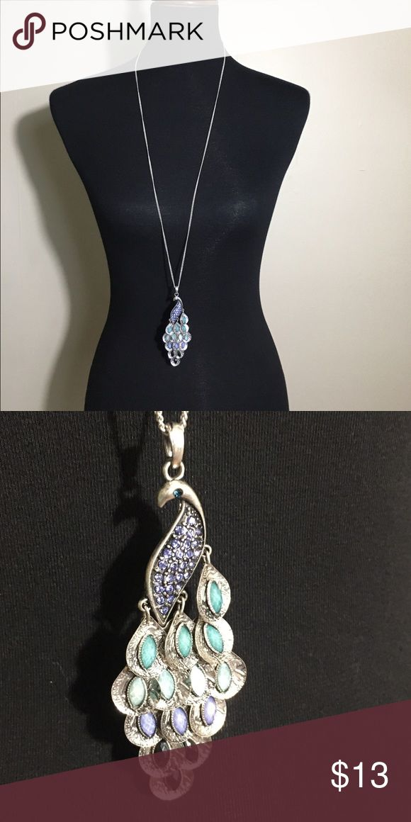 """Peacock necklace - long length Very unique and adorable necklace! Has pretty blue """"tail feathers"""" of different hues. Jewelry Necklaces"""