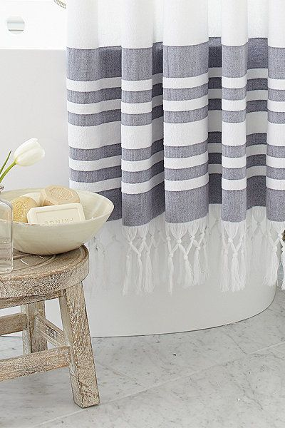 A fresh, more absorbent spin on the traditional Turkish towel. Our Turkish Shower Curtain is woven of lightweight, yarn-dyed dobby cotton and finished with traditional hand knotted fringe. Turkish Shower Curtain features: Coordinates with our Turkish Bath TowelTerrycloth with striped dobby borderLiner required