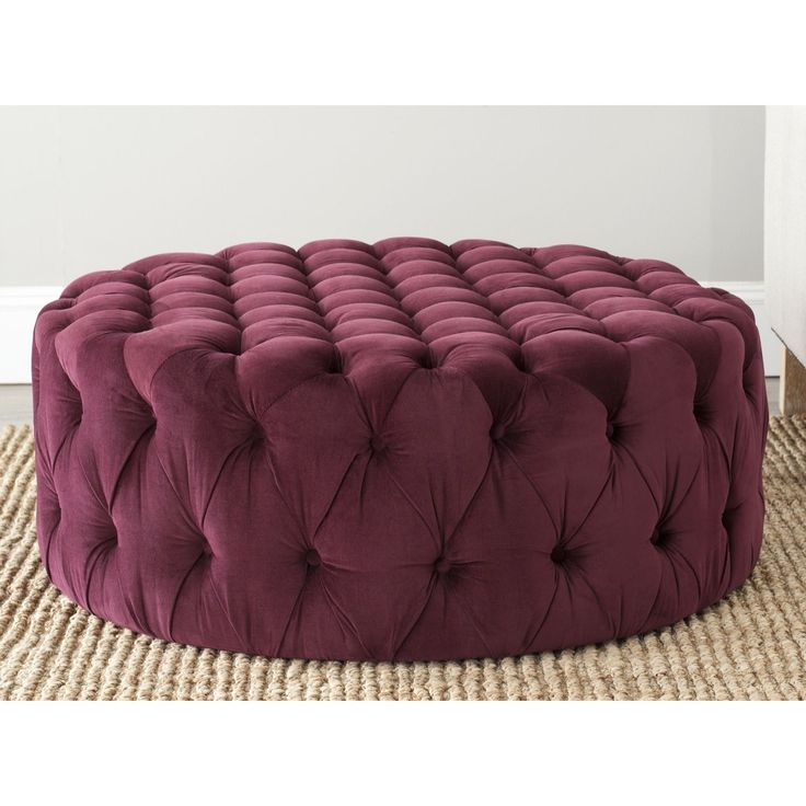 This stunning Charlene ottoman from Safavieh features the sophistication of 1930's Hollywood glamour with a lavish bordeaux color and button-tufted on all sides. This oversized round ottoman is an elegant and versatile accent piece.