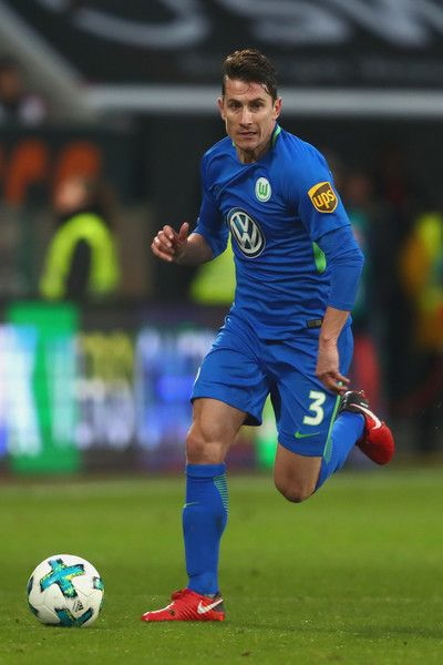 Paul Verhaegh  of Wolfsburg runs with the ball during the Bundesliga match between FC Augsburg and VfL Wolfsburg at WWK-Arena on November 25, 2017 in Augsburg, Germany.