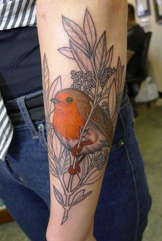 Half finished tattoos are ace. This little beaut of a robin stands out so proud!