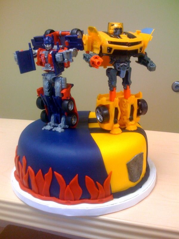 Transformers — Children's Birthday Cakes. best of both here.   Use your child's Action Figures for a cool effect