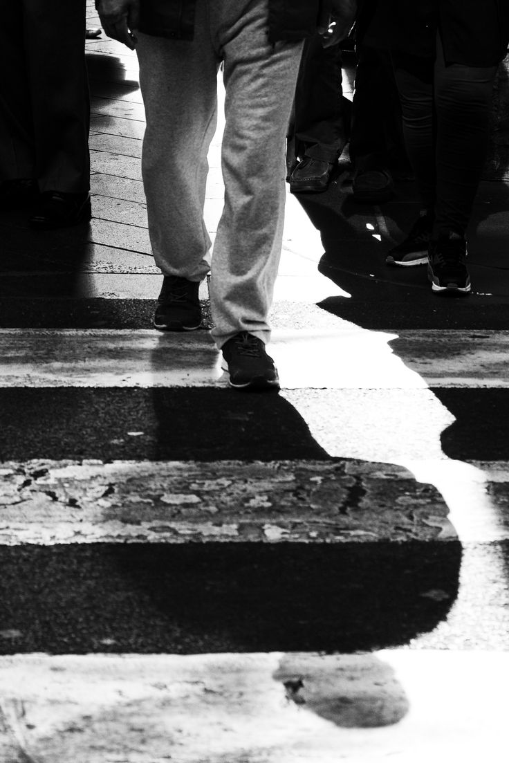 I think this image works really well, compared to the other shadow image - I like how his shadow takes up most of the frame and that there is a common black and white connection between his pants and the road crossing.