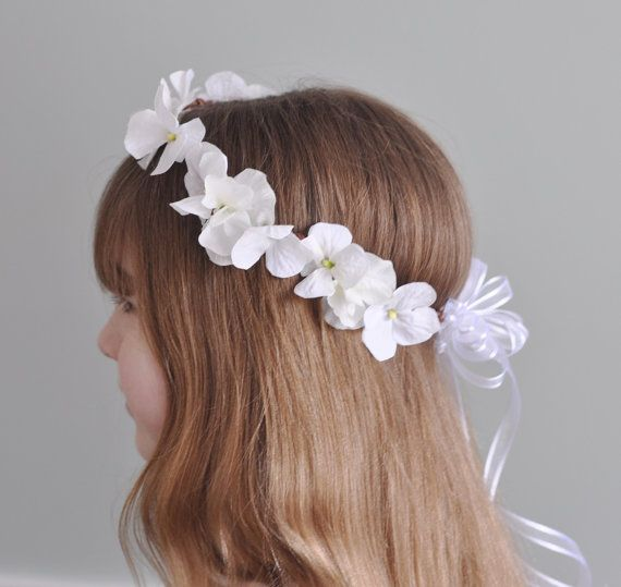 White hydrangea and sweet pea flowers on a grapevine wreath handmade into a floral crown for your flower girl or for her first communion. This wreath is shown in white, and can also be made in ivory. Please measure your childs head where you want the wreath to sit and choose that