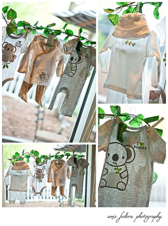 Hang jungle theme baby clothes on a clothesline for the expactant mother as gifts for when the party is over