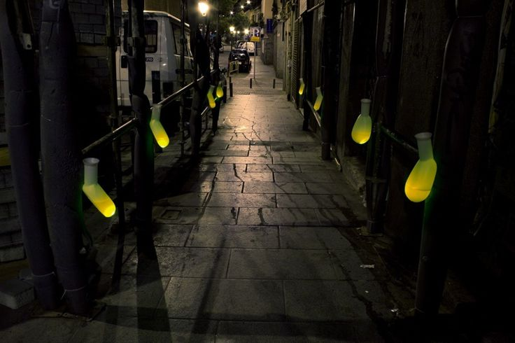 """""""A very crowded area at night time when the atmosphere is great... we installed 80 male urine containers, the ones used in hospitals. Inside we poured yellow water and, what else but our lights."""" """"...during the day and at night time people urinate anywhere in the streets without any embarrassment. Through our installation, we have tried to attract attention -in a comical manner- about the problem we encounter when walking in centric streets and squares."""""""