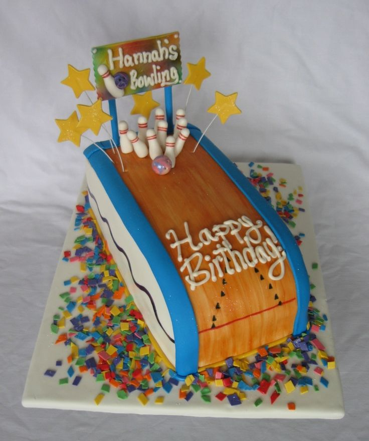 I made this cake for Hannah's birthday that was at a bowling alley. The confetti is cut up dried fondant, the bowling alley is covered in fondant also (the wood is painted on with food coloring gel). The sign is solid gum paste, airbrushed, and piped on with butter cream. The stars, bowling pins, and bowling ball are gum paste too. Enjoy!!