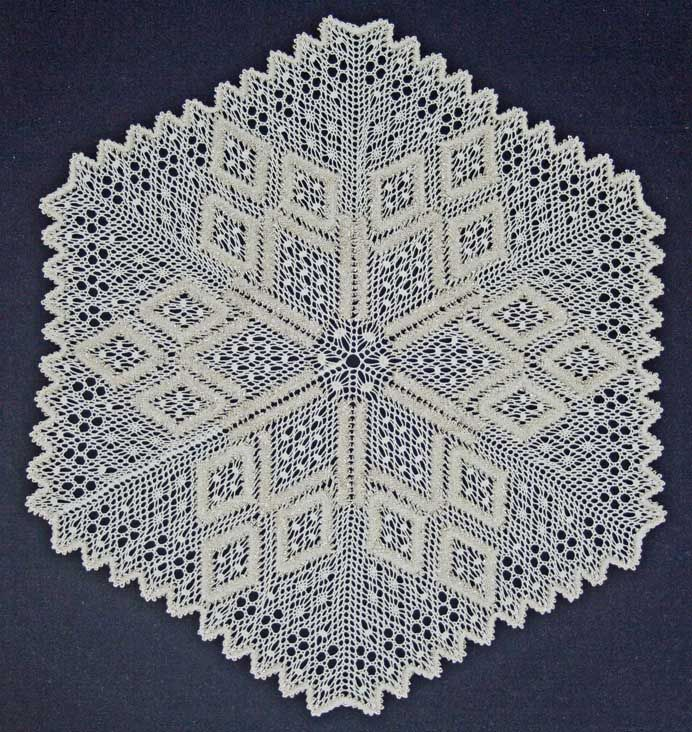 Torchon bobbin lace pattern called Snowflake The Snowflake measures approximately 25cm and uses spiders honeycombe and introduces colour changes The