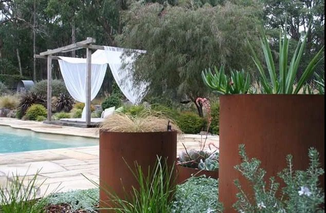 Corten steel planters in various sizes make a focal point in the garden. www.rpgardendesign.com.au