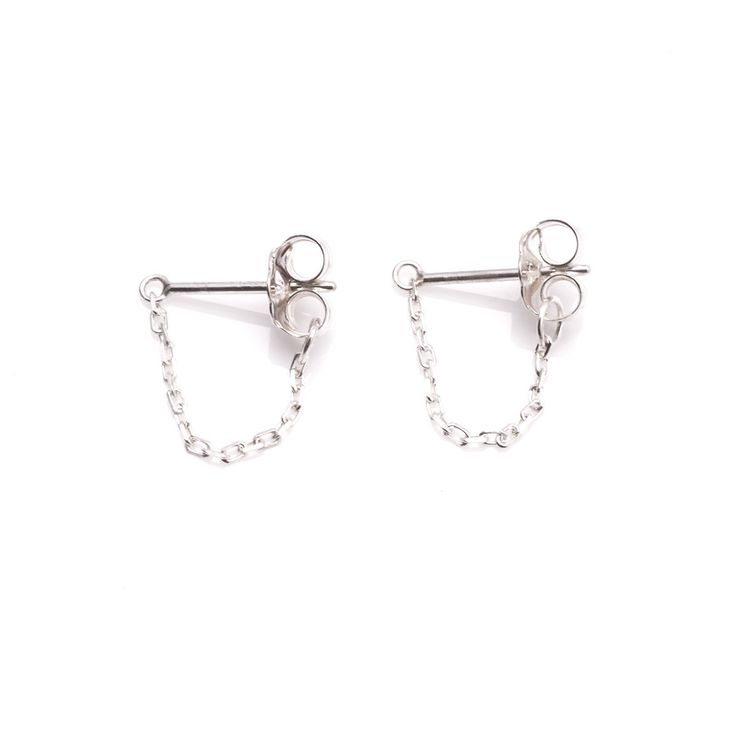 The Molly Earrings by SARAH & SEBASTIAN are a set of stud-style earrings created in sterling silver featuring a looped-chain detailing. Nickel free.