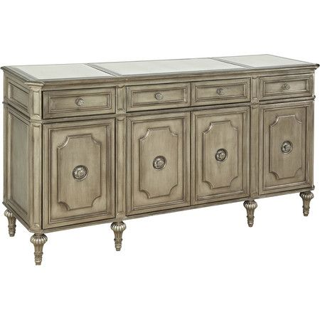 Awash in a silver leaf finish and featuring Victorian-style legs, this beautiful server offers stylish storage for extra table linens and serveware.
