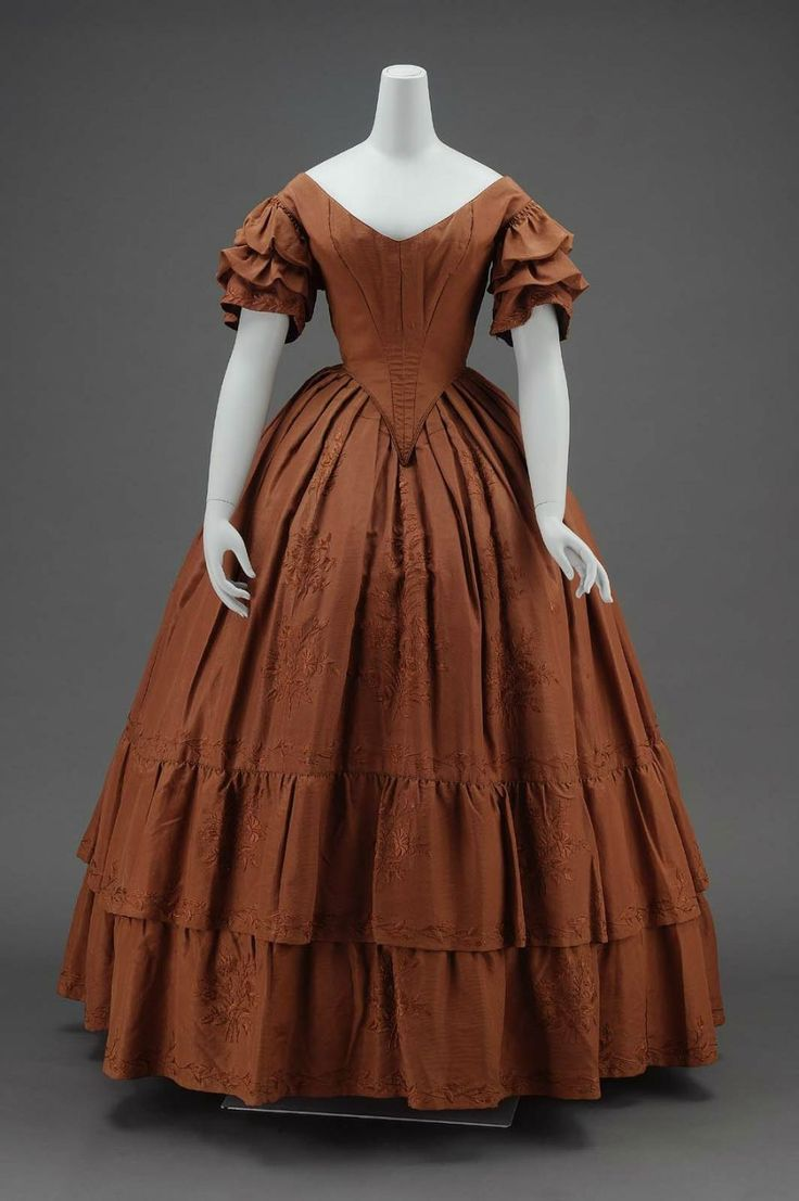 Dinner Dress: ca. 1840, American, silk plain weave (faille) with silk embroidery, glazed cotton plain weave lining, and cotton plain weave gauze sleeve lining.