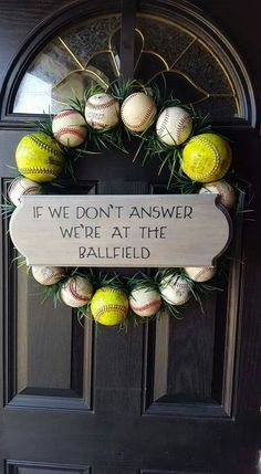 Baseball Softball Door Wreath - this pic was found on Facebook and referenced Pinterest. Devin K Designs on Facebook makes and sells a similar one. Cute DIY craft idea with a wire Wreath form underneath, fake grass and balls.