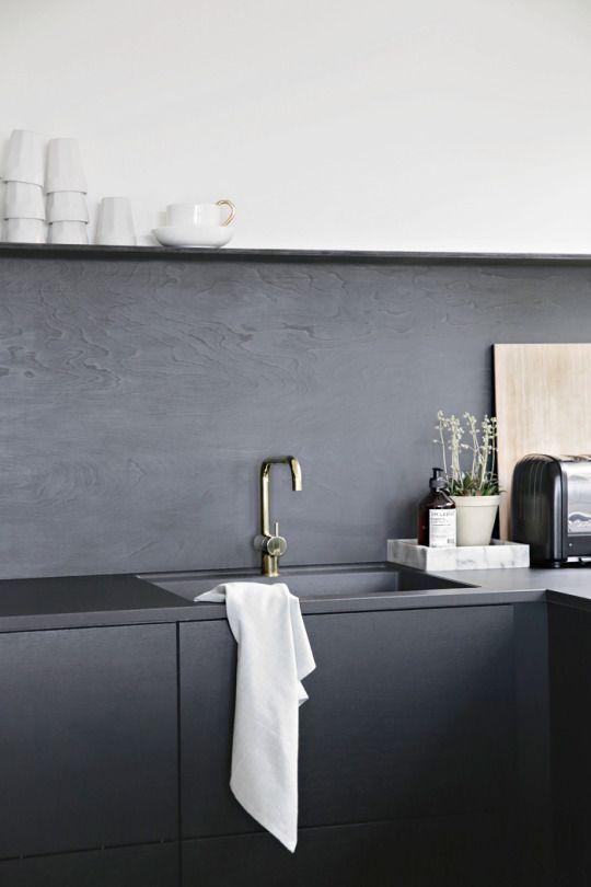 The simple elegance of a black and white kitchen.