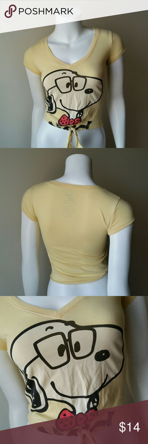 """PEANUTS SNOOPY V-NECK TIE WAIST YELLOW T-SHIRT Peanuts brand, Snoopy, light yellow, v-neck tie waist t-shirt. 60% cotton. 40% polyester. 16"""" flat across from armpit to armpit. 18"""" length. Peanuts Tops Tees - Short Sleeve"""