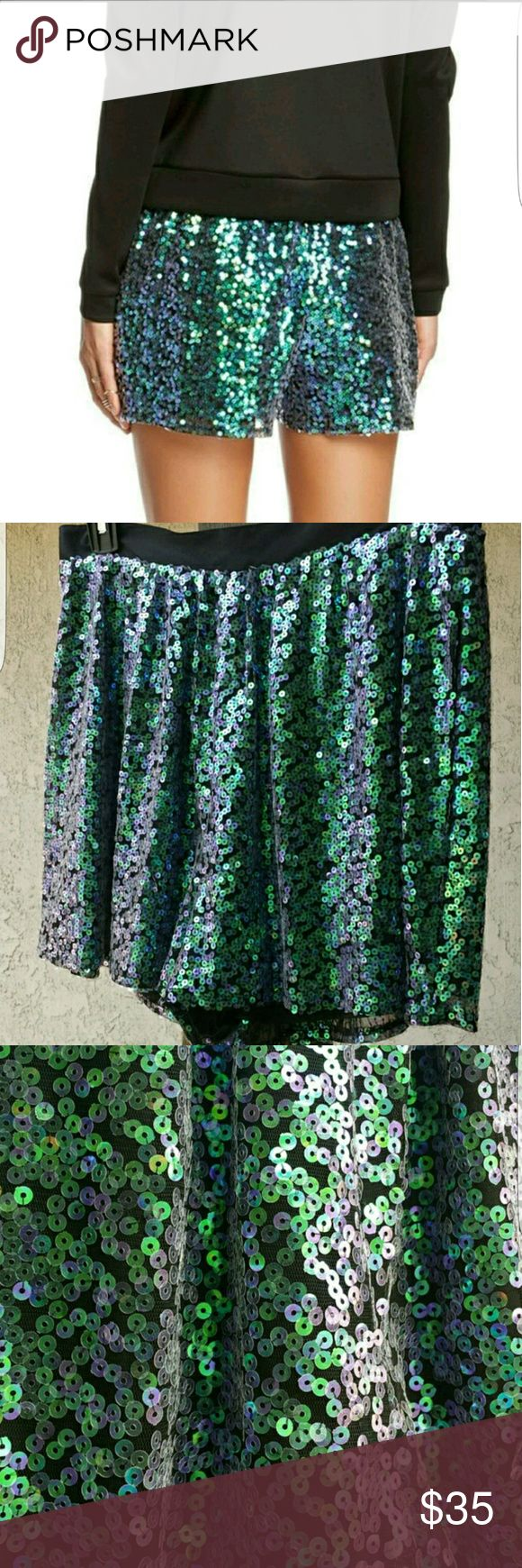 """BCBGeneration iridescent sequined shorts NWT Greenish iridescent shorts... black waistband... hidden zipper in the back & hook and eye closure ... fully lined ....100% polyester..... the size 6 measures approximately 29"""" around the waist and the size 8 measures approximately 30"""" around the waist, both measure approximately 15"""" from the top of the waistband to the hem.....tu10... BCBGeneration Shorts"""