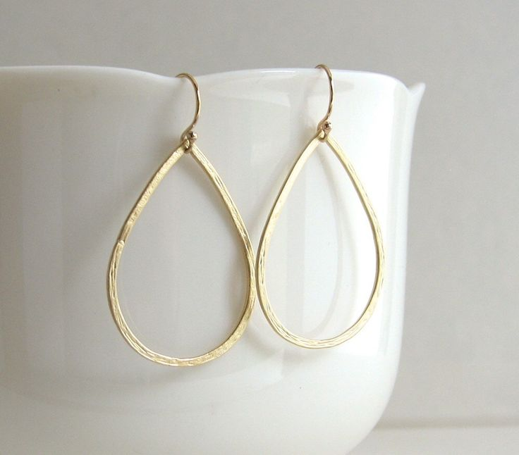 Delicate Hammered Gold Teardrop Hoops, Teardrop Earrings, Gold Teardrop Earrings, Gold Hoop Earrings - 14K Gold-Filled Ear Wires by sterlingandgrace on Etsy https://www.etsy.com/listing/200164407/delicate-hammered-gold-teardrop-hoops
