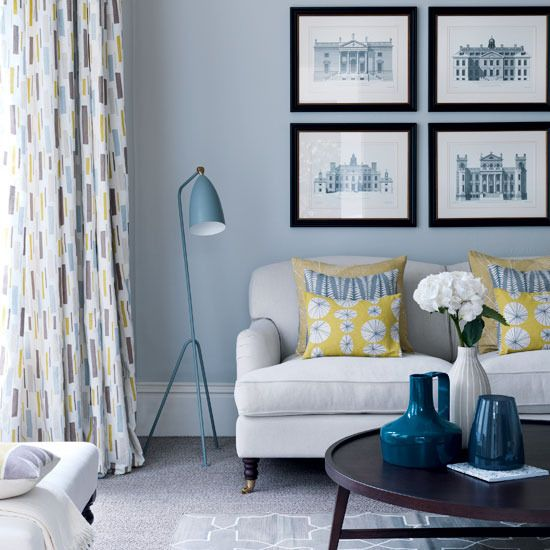 1950s Living Room with Yellows and Grays. I love the mix of this room: the contemporary fabrics and colour mix, the blend of traditional architectural prints and roll arm sofa with the mod lamp and coffee table.