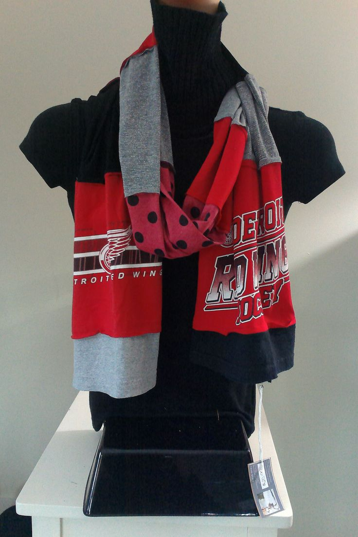 SOLD.    ITEM #DWGS03:  Detroit Red Wings hockey scarf. Measures approx.. 84 in long.