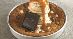 NEW Salted Caramel Pizookie® A little sweet and a little salty. Made with caramel cookie dough, pretzel bites and white and dark chocolate chips. Topped with vanilla bean ice cream, caramel sauce and a Ghirardelli SQUARES® dark chocolate.