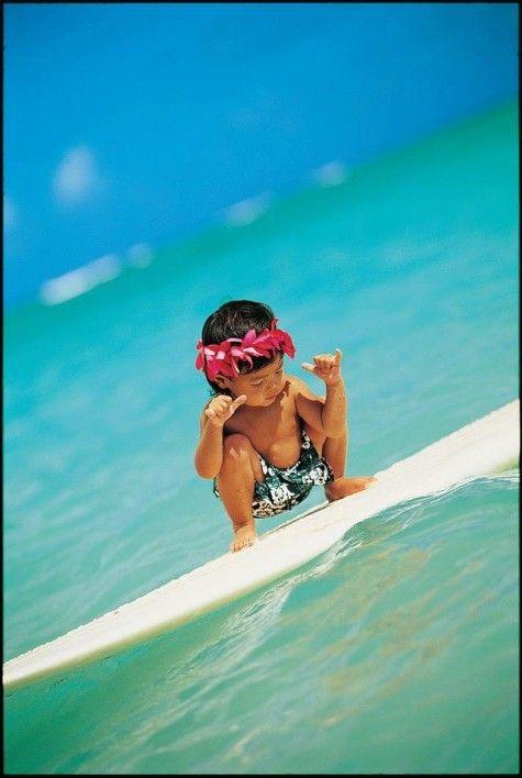 Adorable little boy surfing