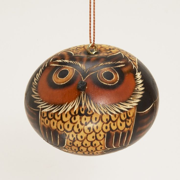 Gourd Owl Ornament Artisans working with Manos Amigas in Lima, Peru, carve the design, after which they accent it with red-hot pieces of burned wood. The gourd is then painted with a natural paint made from ground chalk mixed with water. Later most of the finish is washed off; the residue gives beauty to the carved parts of the design